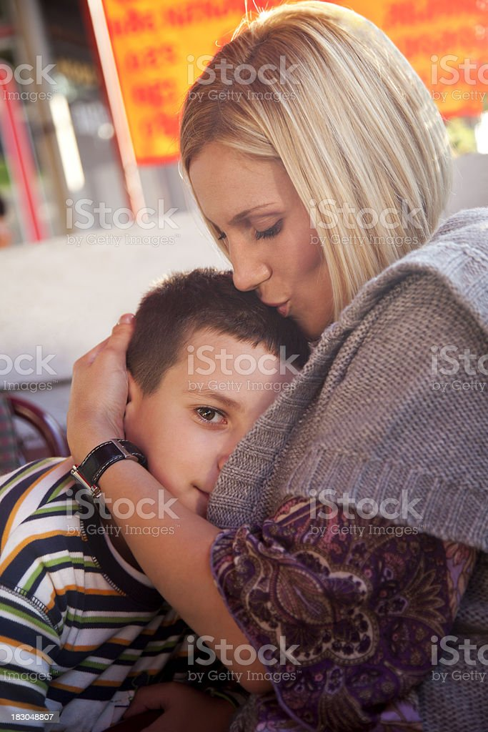 Mother kissing her son royalty-free stock photo