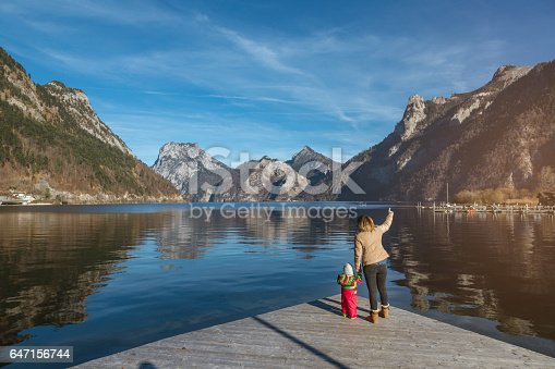 istock Mother learning her baby girl about nature 647156744
