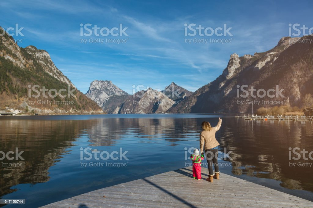 Mother learning her baby girl about nature stock photo