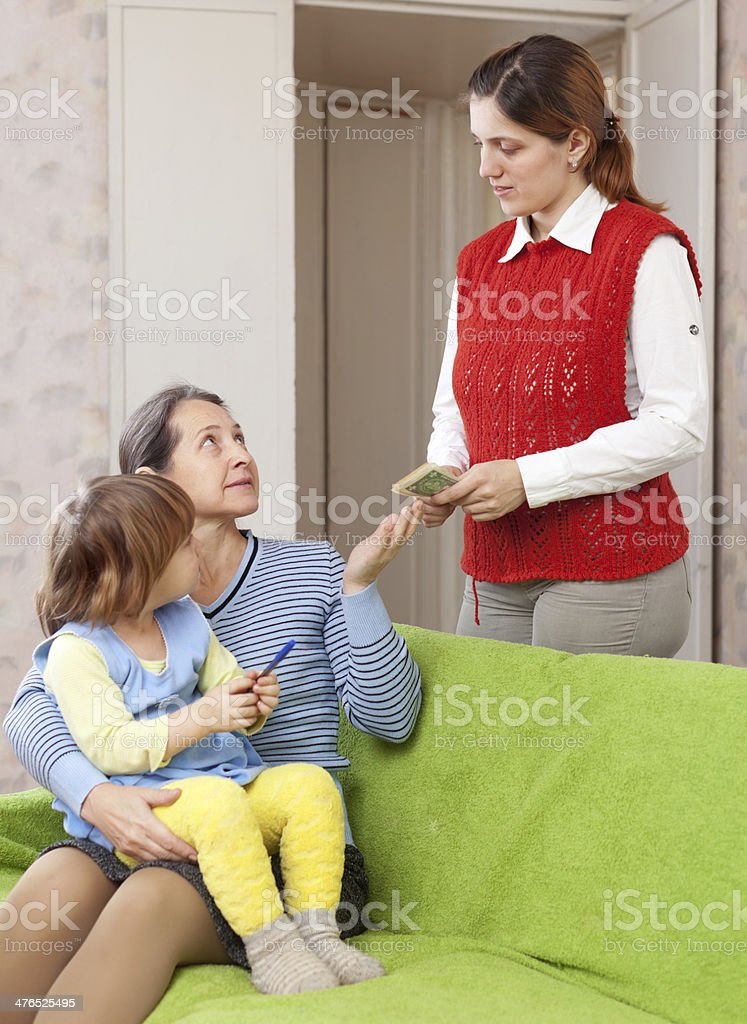 mother leaving baby with nanny royalty-free stock photo