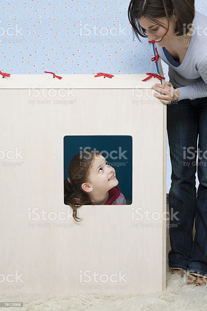 Mother looking at daughter in playhouse royalty-free 스톡 사진