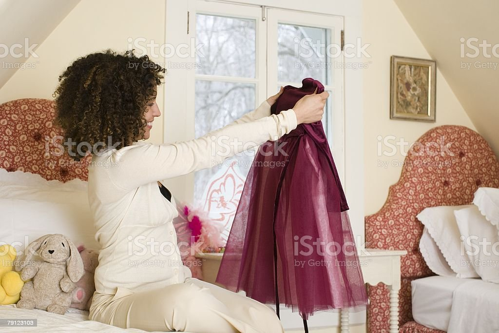 Mother looking at dress 免版稅 stock photo