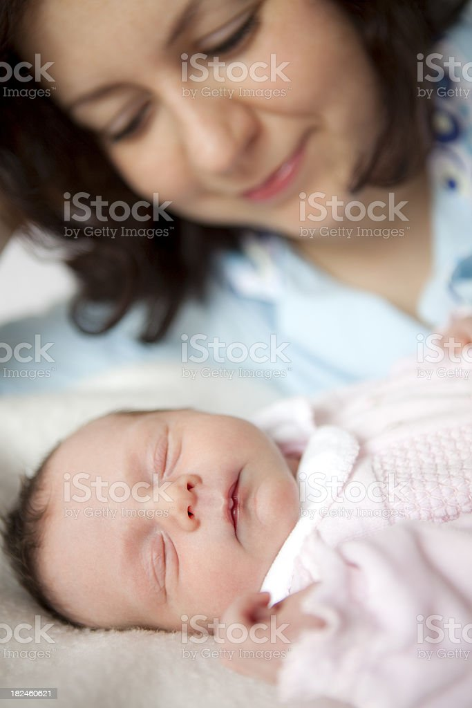 Mother looking at her newborn baby royalty-free stock photo