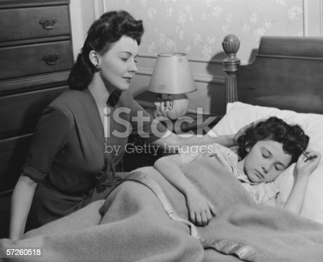 istock Mother looking at sleeping daughter (8-9), (B&W) 57260518