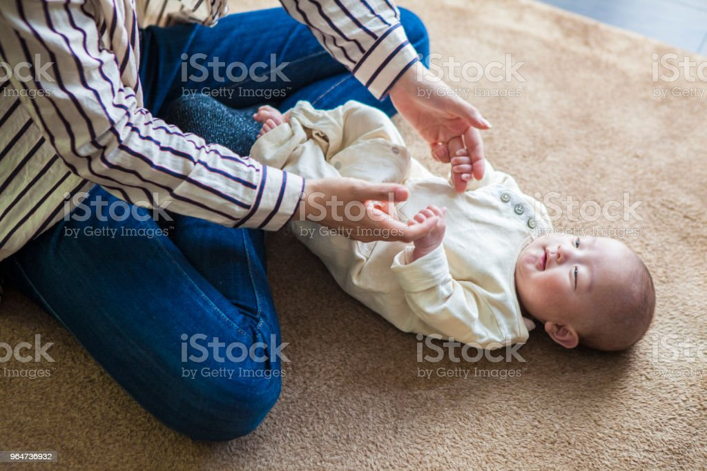 Mother looking at the baby's face. royalty-free stock photo