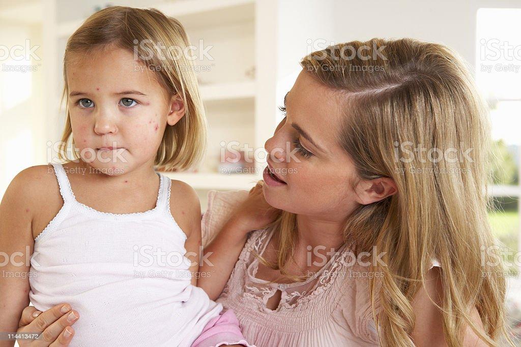 Mother nursing sick child stock photo