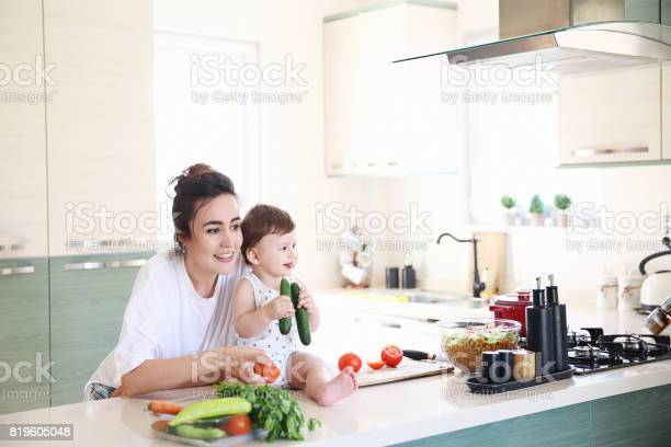 Mother of a woman with a baby cooks the food picture id819605048?b=1&k=6&m=819605048&s=612x612&h=rtygxehy1qp9 dregxxgcjg3c0cbagruszicltksx2s=