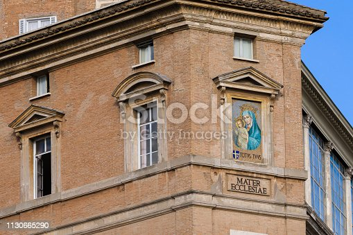 Picture of Mother of God and Child on the Sistine Chapel brown facade corner. Was made in 16 century