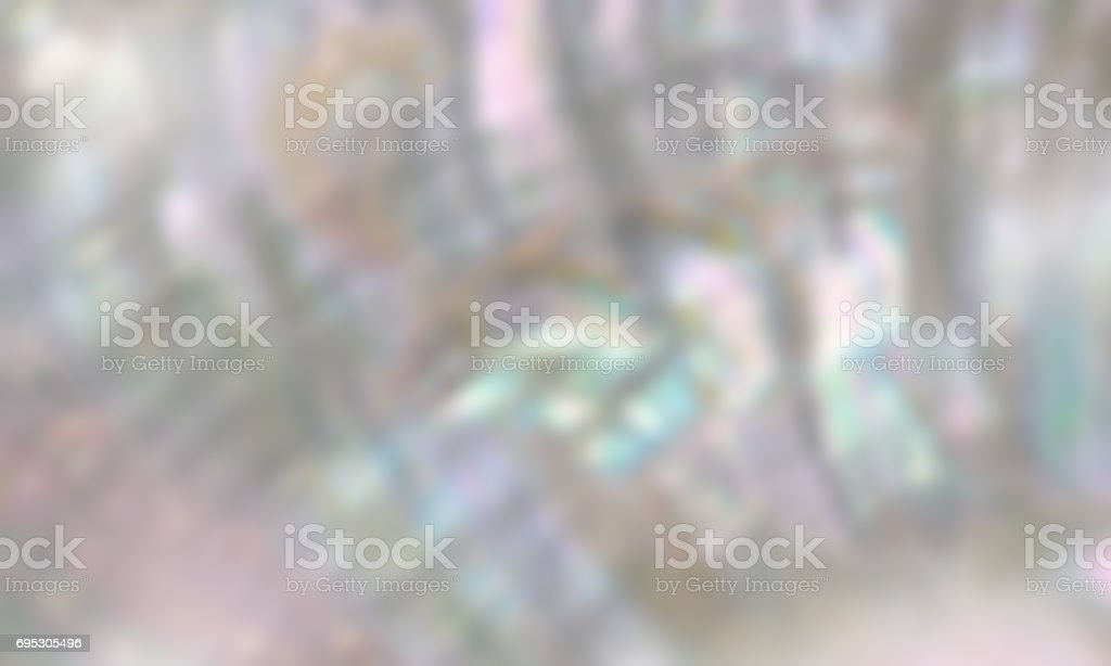 Mother of pearl blurred background with mauve, aqua and prism colours stock photo