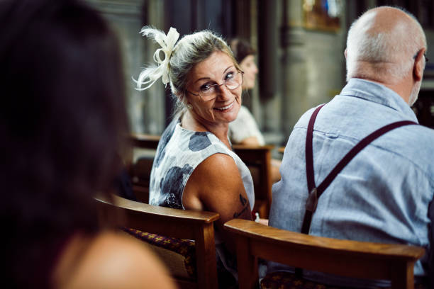 Mother of the bride waiting for her daughter Mother of the bride waiting for her daughter pew stock pictures, royalty-free photos & images