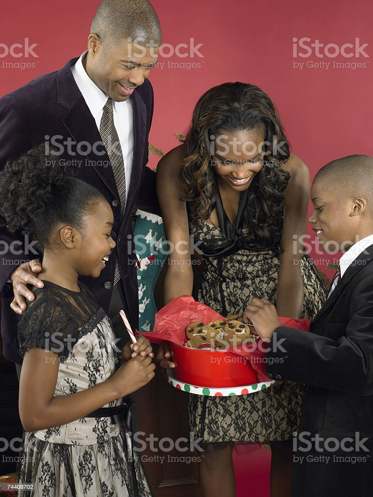 Mother offering children gingerbread men royalty-free stock photo