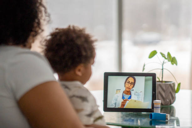 Mother on a remote medical call with a doctor about her sick child stock photo