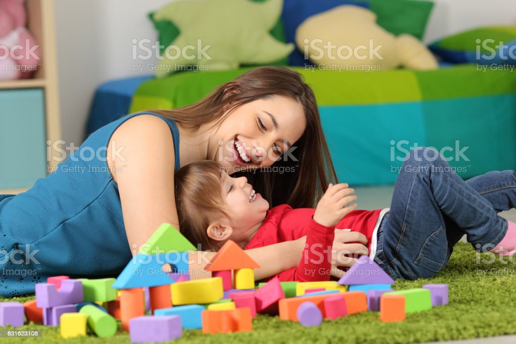 Mother or nanny playing with a child stock photo