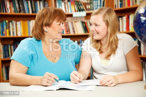 istock Mother or Teacher with Teen Student 153014149