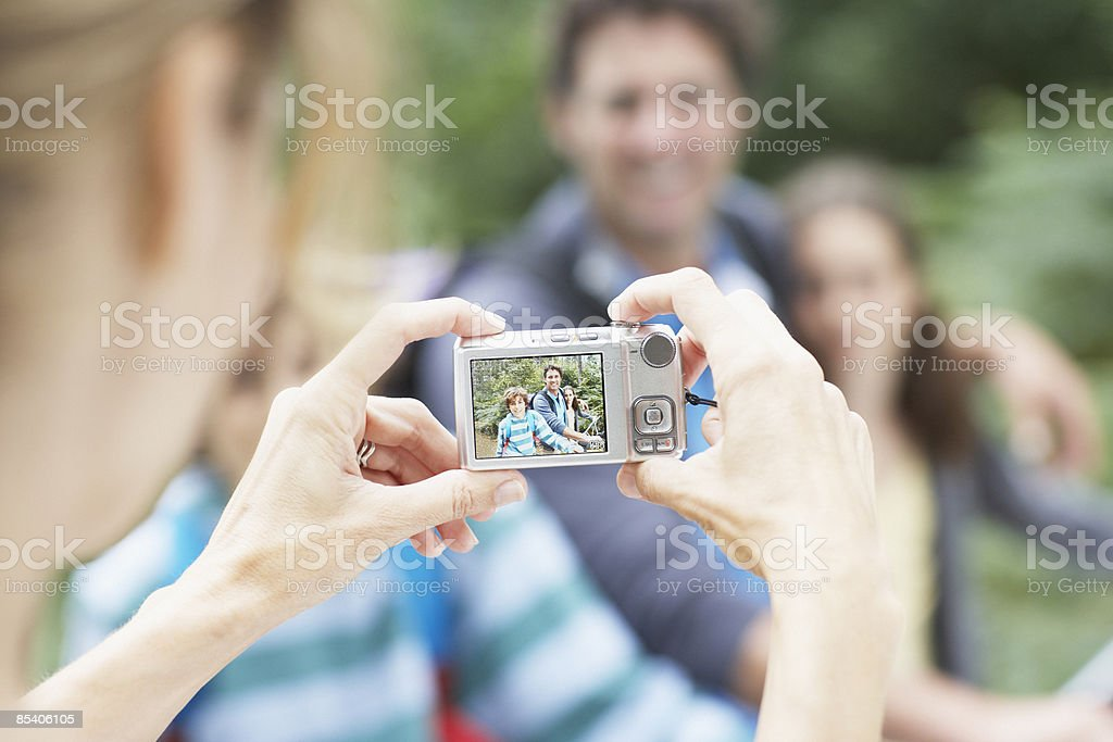 Mother photographing family royalty-free stock photo