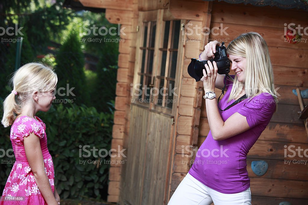 Mother photographing her daughter royalty-free stock photo