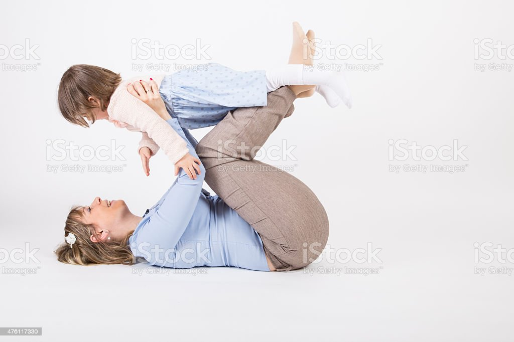 Mother play with her daughter. stock photo