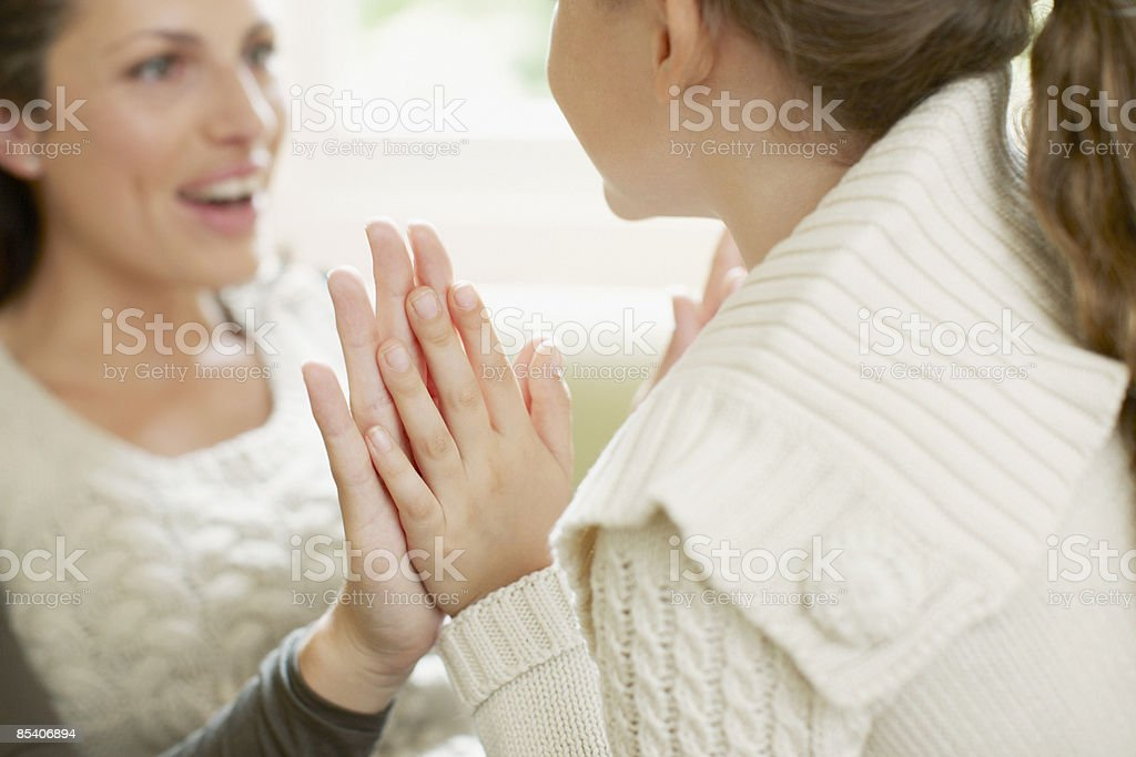 Mother playing clapping game with daughter royalty-free stock photo