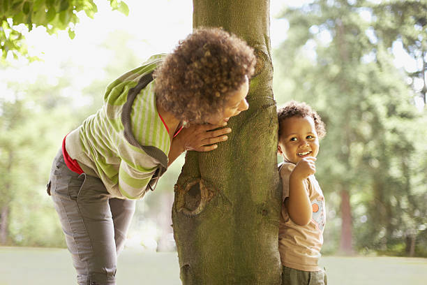 Mother playing hide and seek with son  hide and seek stock pictures, royalty-free photos & images