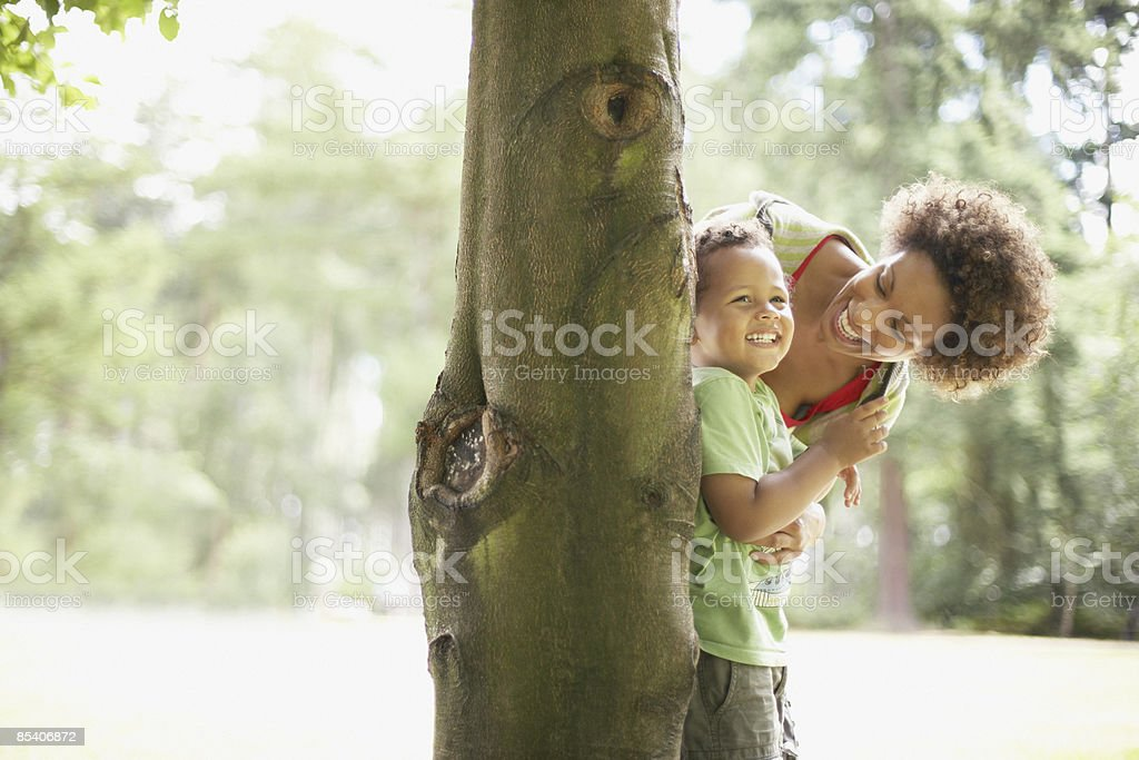 Mother playing hide and seek with son royalty-free stock photo