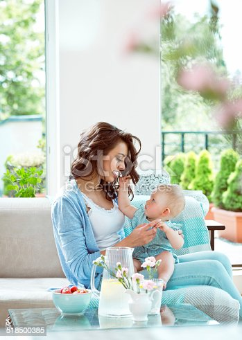 1063760138 istock photo Mother playing with baby 518500385