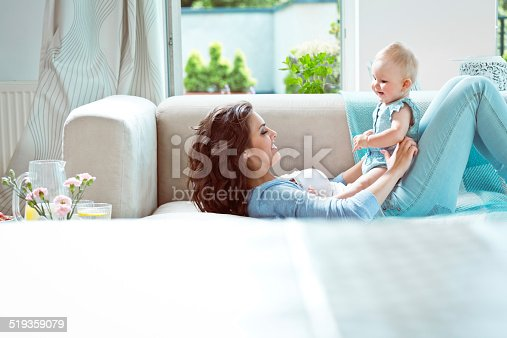 1063760138 istock photo Mother playing with baby 519359079