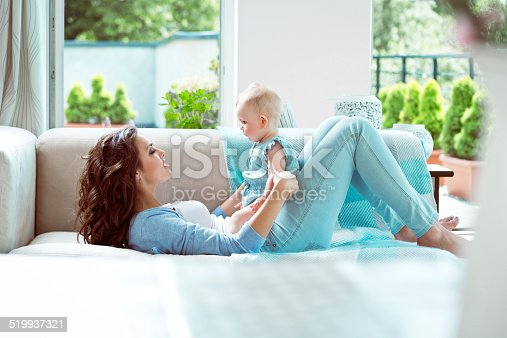 1063760138 istock photo Mother playing with baby 519937321