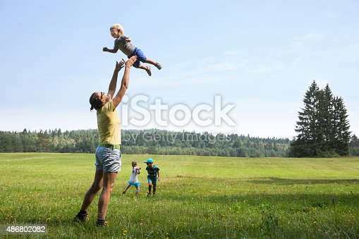 istock Mother playing with children 486802082