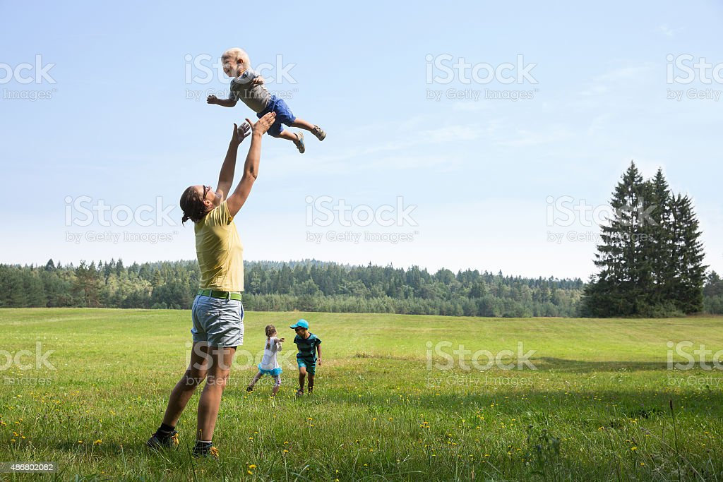 Mother playing with children stock photo