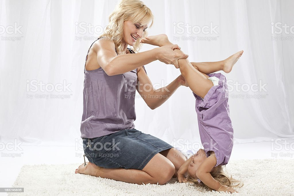 Mother playing with daughter stock photo
