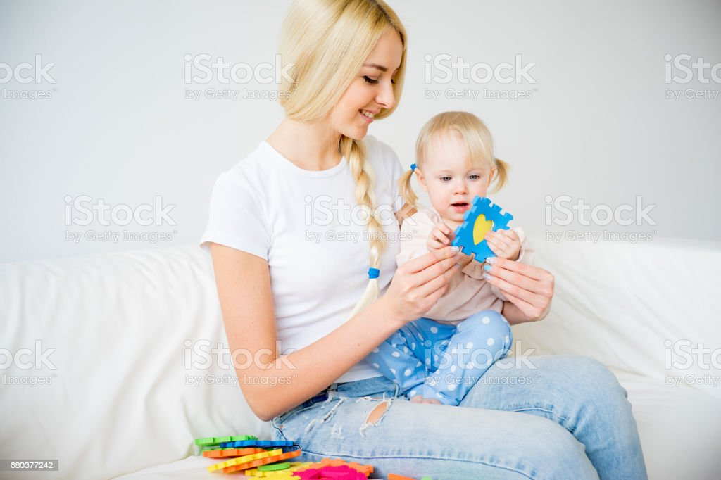 Mother playing with her baby daughter royalty-free stock photo