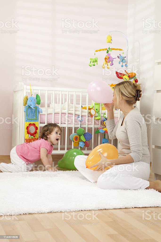 Mother Playing With Her Baby royalty-free stock photo