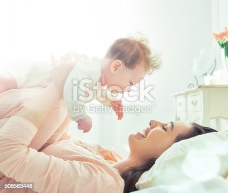 istock mother playing with her baby 508583448