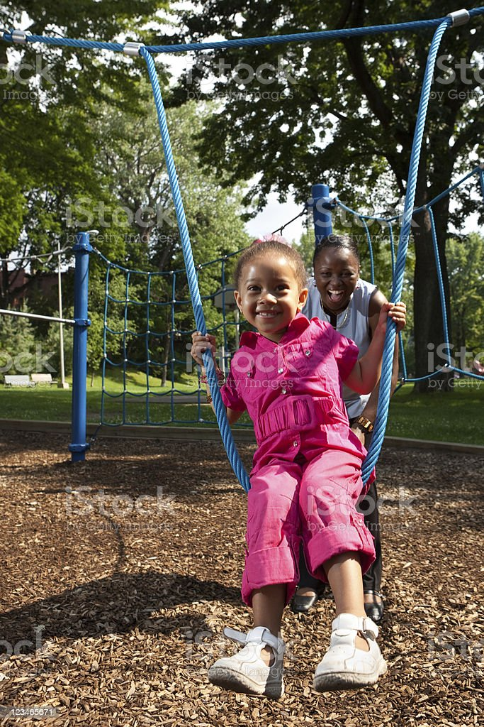 Mother playing with her daughter in a park royalty-free stock photo