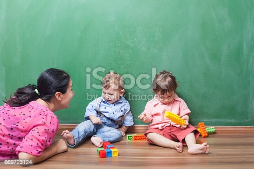 istock Mother Playing With Son And His Friend 669723124