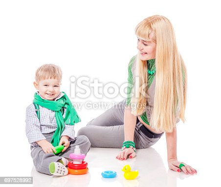 istock Mother playing with son 697528992