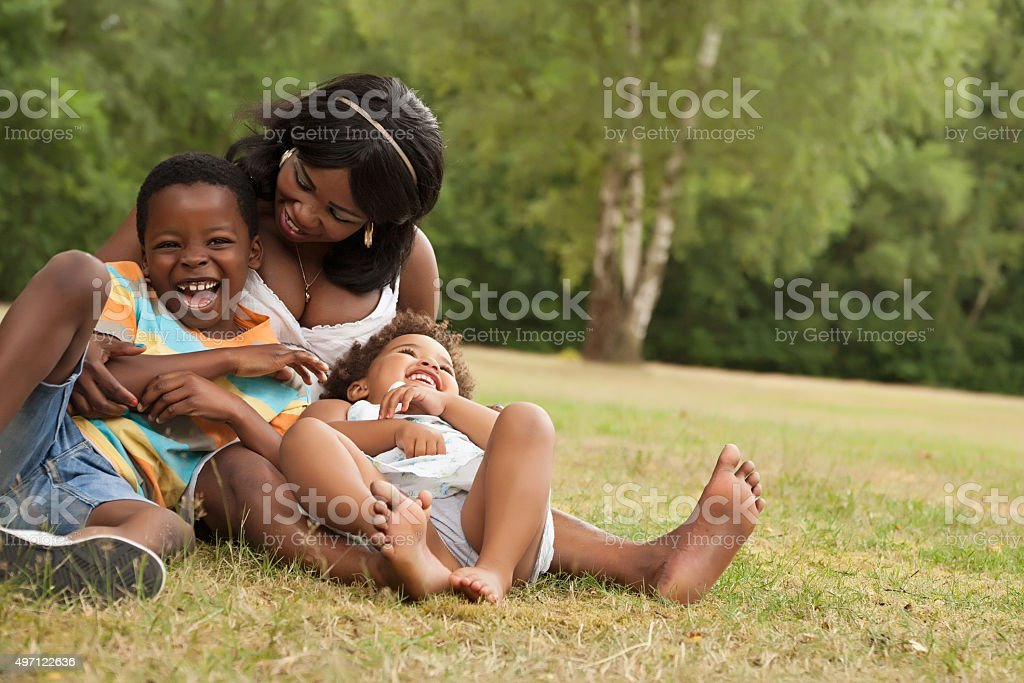 Mother plays with her children stock photo