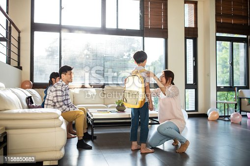 istock Mother preparing son for school at home 1158850683