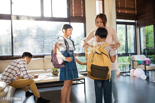 istock Mother preparing two kids for school at home 1152179544