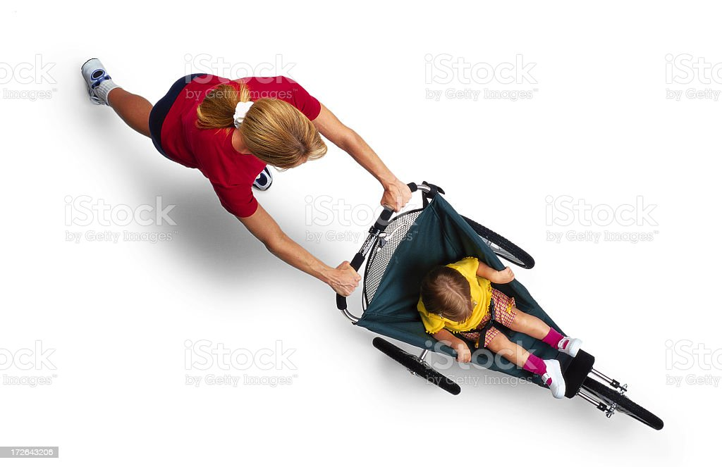 Mother Pushing Child in Jogger stock photo