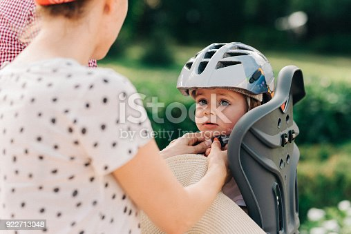 istock Mother putting a helmet on her son's head 922713048