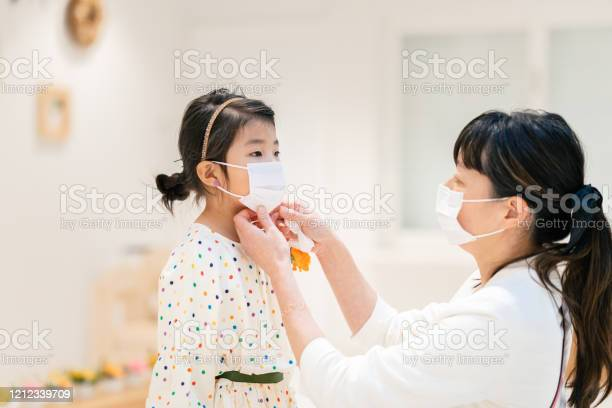 Mother putting protective mask on her daughters face picture id1212339709?b=1&k=6&m=1212339709&s=612x612&h=yhftreuseiembwjm2sgzwhy4bki crzrjq0tkf91gyq=