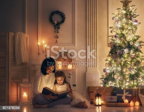 istock mother reading a book 621376234