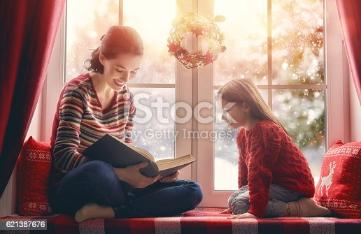 istock mother reading a book 621387676