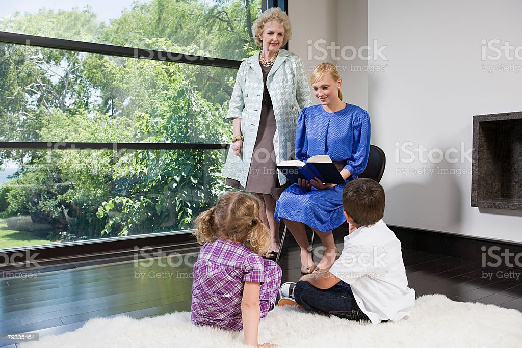 A mother reading a book to her children royalty-free stock photo