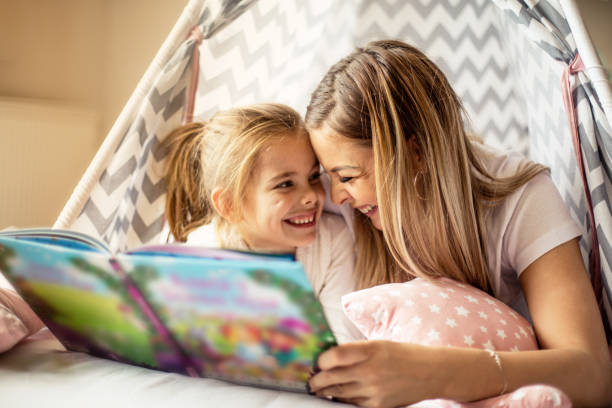 Mother reading a story to her daughter picture id1135520466?b=1&k=6&m=1135520466&s=612x612&w=0&h=6z6cs9zf4kbrwfiex2ed3dy  0osqeearjgaz7fkup0=