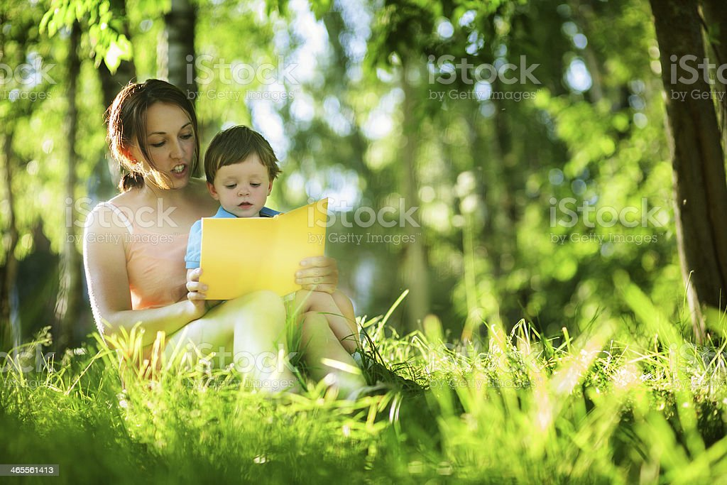 Mother reading book for child royalty-free stock photo