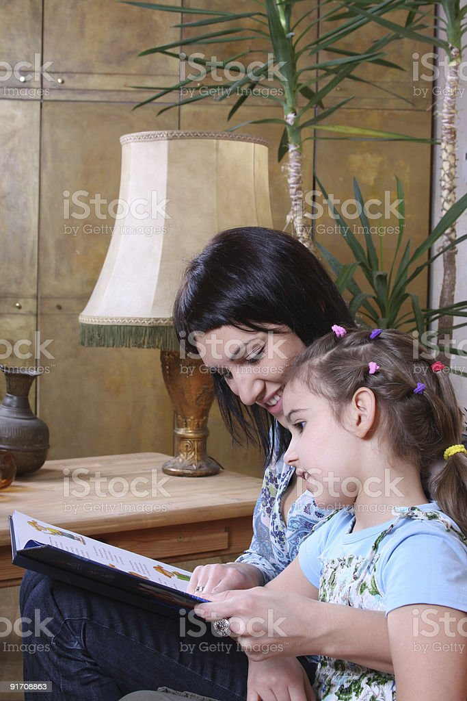 Mother reads book child royalty-free stock photo