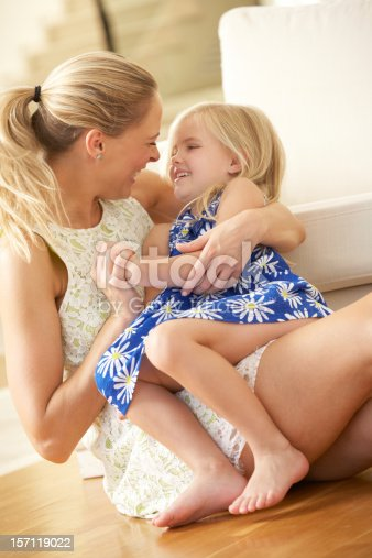 istock Mother Relaxing At Home With Daughter 157119022