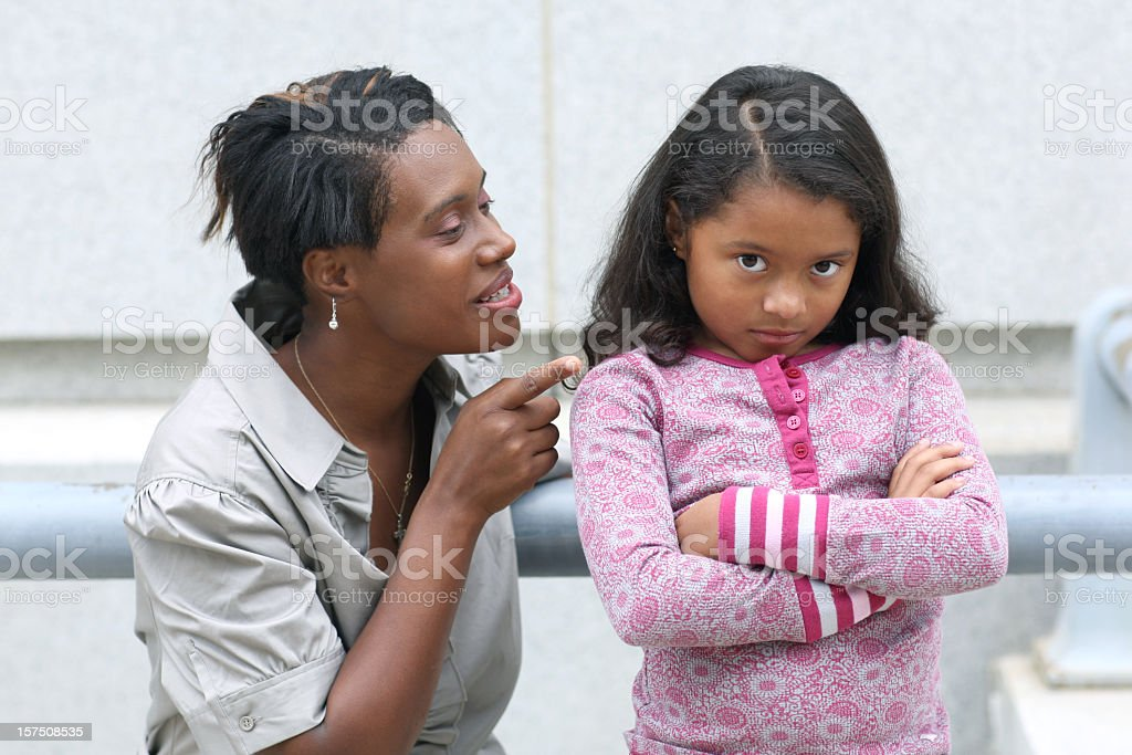Mother reprimanding her daughter. royalty-free stock photo